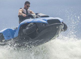 Quadski rider speeding thru water