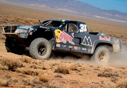 Monster Energy Trophy Truck kicking up dirt in the Baja 1000