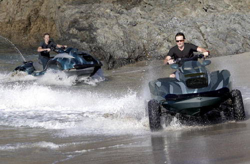 2 Quadski amphibian all terrain vehicles coming out of the water