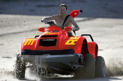 Quadski amphibian all terrain vehicle and jet ski with a lifeguard riding it