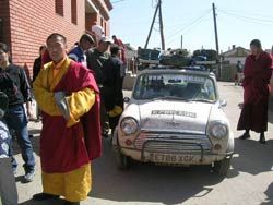 Monks check out some of the Cars participating in the Mongol Rally