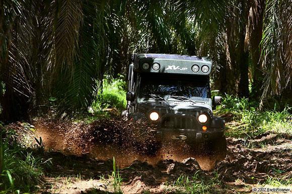 earthroamer plowing through mud bog