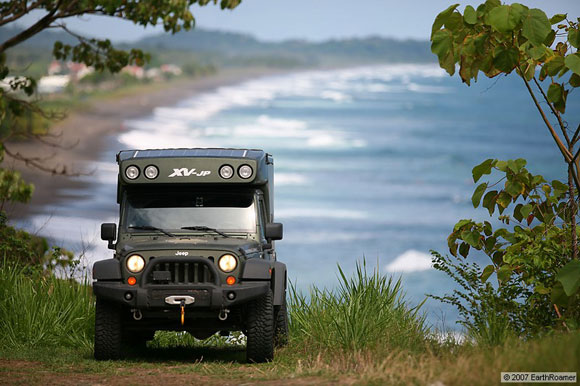 earthroamer all terrain vehicle on a trail with beach in background