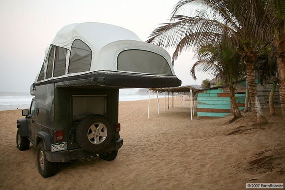 earthroamer allterrain vehicle on the beach with lofttop tent extended