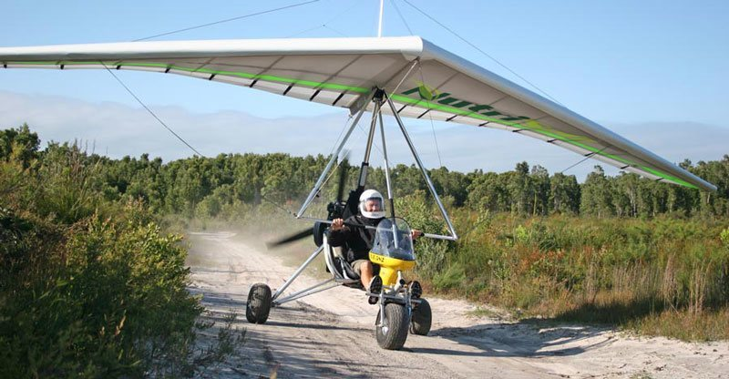 Ultralight trike landing on dirt road