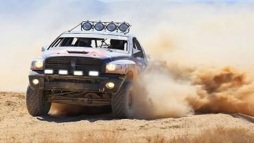 Truck kicking up dust during Baja 1000 Desert Race