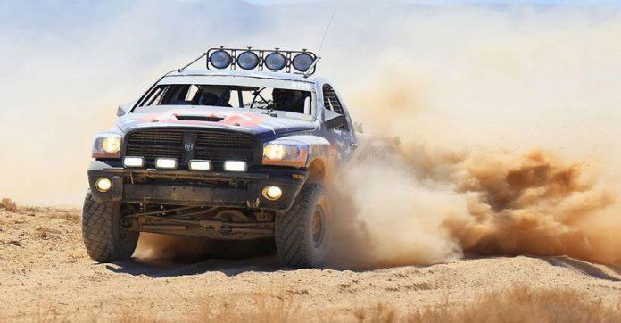 Truck kicking up dust during Baja 1000 Desert Race