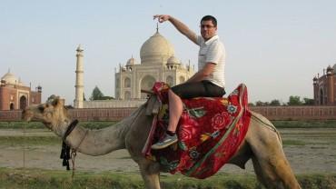 Man Riding Camel during global scavenger hunt 2009