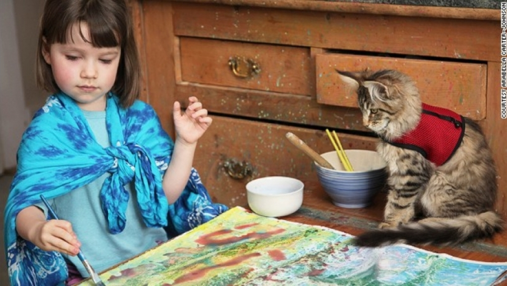 CNN: Portrait of a 6-year-old artist with autism, her therapy cat, and Gemiini