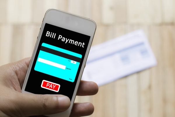 Mobile payment with blur of bill backfround.
