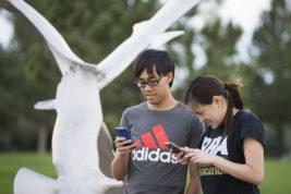 Di Tran and Jennifer Nguyen play Pokemon Go on Monday Aug. 15, 2016 at Sidecreek Park. Photo by Gabriel Christus/Aurora Sentinel