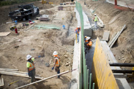 Contractors work on a drainage ditch in the new Stapleton neighborhood on Monday Aug. 22, 2016 in Aurora. Photo by Gabriel Christus/Aurora Sentinel