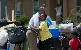 FILE - In this Tuesday, Aug. 23, 2016, file photo, President Barack Obama hugs Marlene Sanders as he visits with with residents of Castle Place, a flood-damaged area of Baton Rouge, La. (Ted Jackson/NOLA.com The Times-Picayune via AP, File)