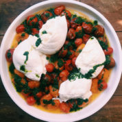 This July 2016 photo shows cherry tomatoes with burrata in New York. This dish is from a recipe by Katie Workman. (Katie Workman via AP)