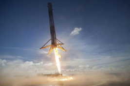 In this May 27, 2016 photo made available by SpaceX, their Falcon rocket booster lands on a platform in the Atlantic Ocean after launching a satellite into orbit. The company says it can save considerable time and money by reusing the big, expensive parts. (SpaceX via AP)