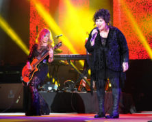 FILE - This June 17, 2013 file photo shows Nancy Wilson, left, and Ann Wilson of Heart performing on opening night of the Heartbreaker Tour at the Cruzan Amphitheater in West Palm Beach, Fla. The husband of Heart lead singer Ann Wilson has been arrested in connection with an incident involving the 16-year-old twin sons of her sister, Nancy Wilson. The Seattle Times reports that 65-year-old Dean Wetter appeared in court Monday, Aug. 29, 2016. (Photo by Jeff Daly/Invision/AP, File)