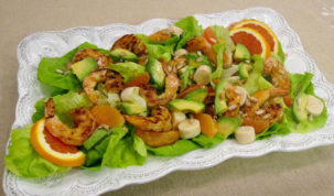 This July 29, 2016 photo shows a salad of spicy grilled shrimp with hearts of palm, avocado, and orange in New York. This dish is from a recipe by Sara Moulton. (Sara Moulton via AP)