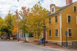 This undated photo provided by GoProvidence shows historic Benefit Street in Providence, R.I., where elms and other trees provide a canopy of color in the fall. The mile-long street runs past a collection of Colonial, Federal and Greek Revival-style homes, and several historic churches. (N. Millard/GoProvidence via AP)