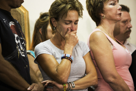 Annie Dalton, Aurora shooting victim Ashley Moser's aunt, holds back tears during a press conference, Tuesday afternoon, Aug. 28 at the Summit Event Center. Families of 11 of the 12 victims at the Century Aurora 16 massacre spoke to the press to voice their concerns with how donations to the victims were being handled.  (Marla R. Keown/Aurora Sentinel)
