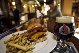 "A barbecue Colorado elk burger waits to be eaten Oct. 18 at Cedar Creek Pub across from the University of Colorado's Anschutz Medical Campus. Cedar Creek supports ""Colorado Proud"" by carrying local companies including 10 breweries, 6 distillers, 3 soda makers, 5 wineries and a list of food services.  (Marla R. Keown/Aurora Sentinel)"