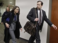 Fox news reporter Jana Winter, left, arrives at an afternoon hearing at district court in Centennial, Colo., on Monday, April 1, 2013, where she was subpoenaed to testify about who gave her confidential information about a notebook James Holmes sent to his psychiatrist days before he allegedly opened fire on a crowded movie theater last July, killing 12 people. (AP Photo/Brennan Linsley)