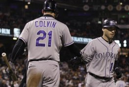 Colorado Rockies' Marco Scutaro, right, is congratulated by Tyler Colvin after after hitting a solo home run off of San Francisco Giants pitcher Santiago Casilla during the ninth inning of a baseball game in San Francisco, Tuesday, May 15, 2012. (AP Photo/Jeff Chiu)