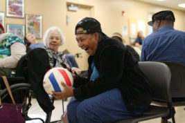Mary Barkley Vaughn laughs during a game of Snoozeball on Monday Sept. 12, 2016 at Morning Star Adult Day Care. Photo by Gabriel Christus/Aurora Sentinel