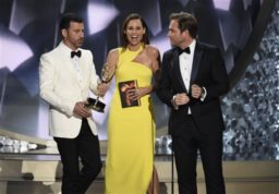 "Host Jimmy Kimmel, left, takes the Emmy Award from presenters Minnie Driver, center, and Michael Weatherly after announcing Maggie Smith was the winner of the best supporting actress award for her role in ""Downton Abbey"" at the 68th Primetime Emmy Awards on Sunday, Sept. 18, 2016, at the Microsoft Theater in Los Angeles. (Photo by Chris Pizzello/Invision/AP)"