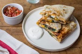 This August 2016 photo shows spinach, mushroom, and chicken quesadillas in New York. This dish is from a recipe by Katie Workman. (Sarah Crowder via AP)