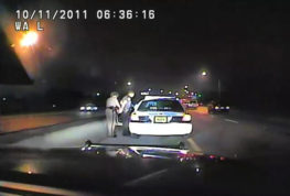 ADVANCE FOR USE WEDNESDAY, SEPT. 28, 2016 AND THEREAFTER-In this image made from an Oct. 11, 2011 video made available by the Florida Department of Highway Safety and Motor Vehicles, Florida Highway Patrol Officer Donna Watts arrests Miami Police Department Officer Fausto Lopez who was traveling at 120 miles per hour to an off-duty job, in Hollywood, Fla. After the incident, Watts says that she was harassed with prank calls, threatening posts on law enforcement message boards and unfamiliar cars that idled near her home. In lawsuits, she accused dozens of officers of obtaining information about her in the state's driver database. (Florida Department of Highway Safety and Motor Vehicles via AP)