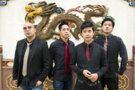 """This photo provided by Anthony Pidgeon, taken Aug. 21, 2015, shows the Asian-American band The Slants, from left, Joe X Jiang, Ken Shima, Tyler Chen, Simon """"Young"""" Tam, Joe X Jiang in Old Town Chinatown, Portland, Ore. The Supreme Court will hear a First Amendment challenge over the government's refusal to register offensive trademarks in a case that could affect the Washington Redskins. The justices agreed Thursday, Sept. 29, 2016, to take up a dispute involving an Asian-American rock band called the Slants, but did not act on a separate request to hear the higher-profile Redskins case at the same time. (Anthony Pidgeon/Redferns via AP)"""