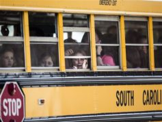 A Townville Elementary student looks out of the window of a school bus as she and her classmates are transported to Oakdale Baptist Church, following a shooting at Townville Elementary in Townville Wednesday, Sept. 28, 2016. A teenager killed his father at his home Wednesday before going to the nearby elementary school and opening fire with a handgun, wounding two students and a teacher, authorities said. (Katie McLean/The Independent-Mail via AP)