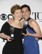 "FILE - In this June 7, 2015 file photo, Lisa Kron, left, and Jeanine Tesori pose with the award for best score for ""Fun Home"" in the press room at the 69th annual Tony Awards in New York. ""Fun Home,"" the 2015 Tony-winning best musical, has begun its national tour as the first Broadway show with a lesbian protagonist, one who is dealing with a parent's suicide and her own sexuality. (Photo by Evan Agostini/Invision/AP, File)"