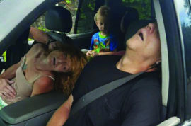 In this Wednesday, Sept. 7, 2016 photo released by the East Liverpool Police Department, a young child sits in a vehicle behind his grandmother and a man, both of whom are unconscious from a drug overdose, in East Liverpool, Ohio. The police department said it's trying to show the impact of the heroin and painkiller epidemic by sharing photos of the boy sitting in the vehicle behind the slumped-over adults who were later revived with an overdose antidote. The couple faces child-endangering and other charges. (East Liverpool Police Department via AP)