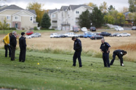 Aurora Police investigate a crime scene where a dead body was discovered earlier in the morning at Side Creek Park in Aurora on Oct. 6.   Photo by Michael Ortiz/ Auora Sentinel