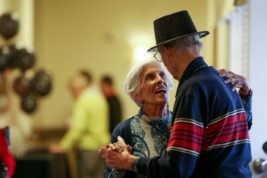 Joan Silar dances with her husband, Jim Silar, who is a resident at Chelsea Place, during a vintage Hollywood photo exhibit on Friday Oct. 14, 2016 at Chelsea Place. Ken Gustafson, executive chef at Chelsea Place, brought photos from his wife's Dream Theater in Russell, Kansas for the residents. The staff made a party out of the occasion. Photo by Gabriel Christus/Aurora Sentinel