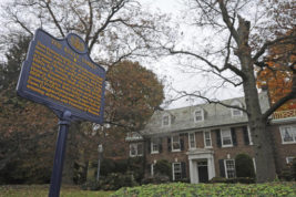 """FILE - In this Oct. 25, 2012, file photo, a blue state historical marker sits outside Grace Kelly's family's home in Philadelphia. The Philadelphia home where Oscar-winning actress Kelly grew up and accepted a marriage proposal from Prince Rainier III of Monaco in 1955 is now in the hands of the royal family. Kelly's son, Prince Albert, tells People Magazine, Friday, Oct. 21, 2016,  he was the recent purchaser of the East Falls home, which he called """"very special to our family."""" His mother, the beloved actress, died in 1982.(April Saul/The Philadelphia Inquirer via AP, File)"""
