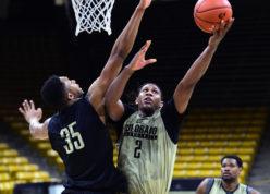 University of Colorado forward, Xavier Johnson, (2) goes to the basket on Dallas Walton (35) during basketball media day, Tuesday, Oct. 25, 2016, in Boulder, Colo. (Cliff Grassmick/Daily Camera via AP)