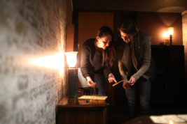 Brooke Snowdon, left, and Mollie Hayden try to solve a puzzle on Wednesday Oct. 26, 2016 at King's Escape Room. Photo by Gabriel Christus/Aurora Sentinel
