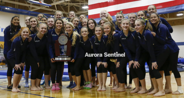 Overland High School gymnastics team takes second in the state on Nov. 3 at Thornton High School. Photo by Michael Ortiz/ Aurora Sentinel