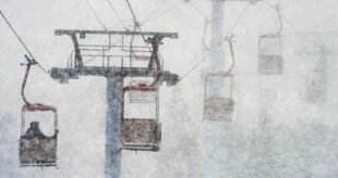 This March 14, 2016, file photo, shows heavy snow blanketing skiers as they ride the gondola from the parking lot to the base of the mountain at Canyons Village ski area in Park City, Utah. Utah resorts still want skiers and snowboarders to come enjoy their groomed slopes and high speed lifts this season, but they're also offering expanded options for people who want to get a taste of the backcountry without the risk of going alone. (Steve Griffin/The Salt Lake Tribune via AP, File)