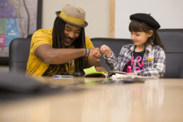 Aurora's Poet Laureate, Jovan Mays, met with Olivia Gonzalez, 8, to talk about and read poetry on Tuesday Nov. 15, 2016 at Aurora Municipal Center. Olivia was named Junior Poet Laureate for the day. Photo by Gabriel Christus/Aurora Sentinel