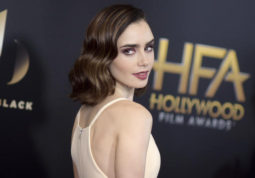 """FILE - In this Sunday, Nov. 6, 2016 file photo, Lily Collins arrives at the 20th annual Hollywood Film Awards at the Beverly Hilton Hotel in Beverly Hills, Calif. Collins, who stars in """"Rules Don't Apply,"""" said she likes physical gifts that can double as art. """"I have a collection of vintage film cameras and old film strips and old film reels in my apartment and I've given them as gifts if I find a really hard to find, rare one,"""" she said. (Photo by Richard Shotwell/Invision/AP, File)"""