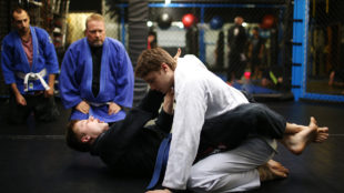 Robin Solsbery, left, demonstrates a choke on his twin brother, Ryan, during an introductory jiu jitsu class Nov. 2 at High Altitude Martial Arts. Reporter Brandon Johansson got a firsthand, or first-fist look, if you will at the world of mixed martial arts.