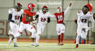 Regis Jesuit High School sophomore Kiahn Martinez carries the ball for a 67-yard touchdown against Fairview on Friday Nov. 11, 2016 at Regis Jesuit High School. the Raiders beat the Knights 48-28 in the first round of the playoffs. Photo by Gabriel Christus/Aurora Sentinel