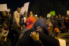 Danni Scrite, left, hugs Ariel Tomlinson during an anti-Trump rally on Thursday Nov. 10, 2016 in Denver. Photo by Gabriel Christus/Aurora Sentinel