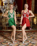In this Nov. 22, 2016 photo released by Madison Square Garden, Radio City Rockettes Katelyn Gaffney, of Clark, N.J., left, and Megan Levinson, of North Caldwell, N.C., pose on the mezzanine level at Radio City Music Hall in New York. Gaffney and Levinson have become best friends in the Radio City cast. For the past seven seasons, they've been tasked with as many as five, 90-minute shows a day. Both also have appeared in the Rockettes' summer show. (Carl Scheffel/MSG Photo Services via AP)