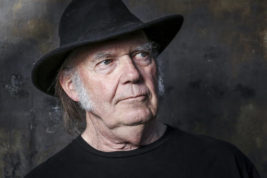 "FILE - In this May 18, 2016, file photo, Neil Young poses for a portrait in Calabasas, Calif., to promote his new album, ""Earth."" Young penned an open letter on Facebook posted on Monday, Nov. 28, 2016, in which he calls for President Barack Obama ""to step in and end"" what he calls the ""violence"" against protesters demonstrating against an oil pipeline being built on part of an Indian reservation in North Dakota. (Photo by Rich Fury/Invision/AP, File)"