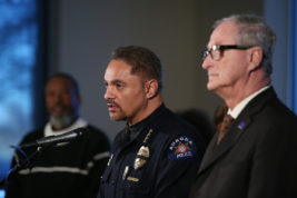 Aurora Mayor Steve Hogan stands by Aurora Police Chief Nick Metz as he talks to the press Nov. 30 at the Aurora Municipal Center to address the rise in hate crimes in Aurora, including two in the past week. Photo by Gabriel Christus/Aurora Sentinel