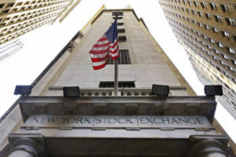 FILE - In this Friday, Nov. 13, 2015, file photo, the American flag flies above the Wall Street entrance to the New York Stock Exchange. More gains in Goldman Sachs and Chevron helped pull the Dow Jones industrial average to another record high even as other indexes were flat to lower in early trading Thursday, Dec. 1, 2016.  (AP Photo/Richard Drew, File)